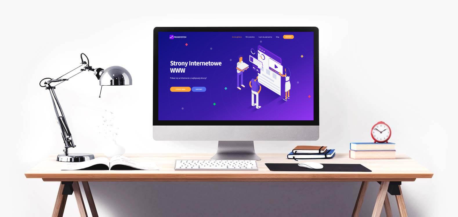 Biurko z monitorem, wyświetlana strona internetowa